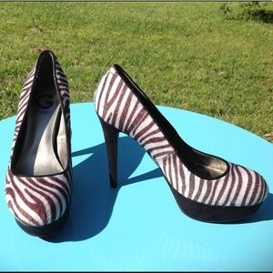 Zebra print platform pumps by Guess
